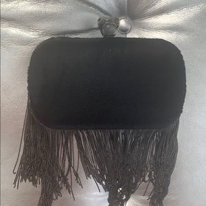 House of Harlow serpent fringe clutch